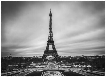 Photo pour Dramatic Eiffel tower in France without people and cars around and empty streets of  Paris. Postcard apocalyptic  concept image of Black and white. - image libre de droit
