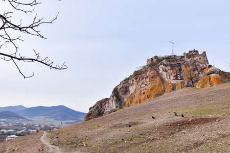 Kveshi fortress with pathway and cross on top. Historical and cultural heritage n Georgia.