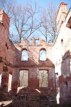 Weathered remains of medieval country estate built with red bricks