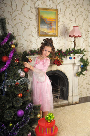 Girl decorating Christmas tree retro