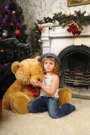 Girl with a big teddy bear