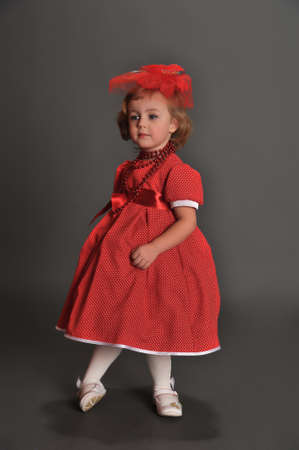 well-dressed little girl in red dress