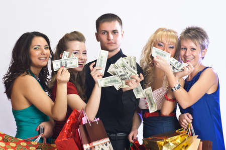 women with shopping bags take money from the man