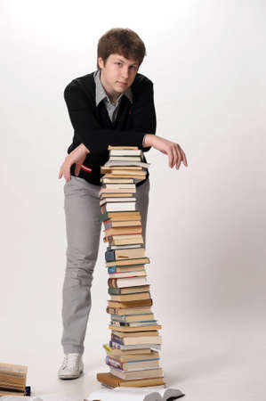 student with a huge stack of books