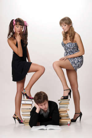 young man and two girls prepare for examinations