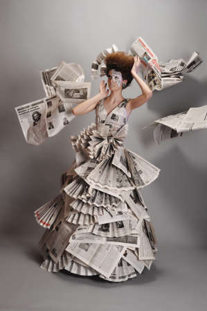 Girl in the newspaper