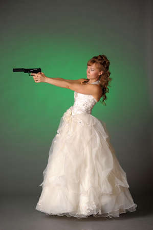 beautiful bride with a gun