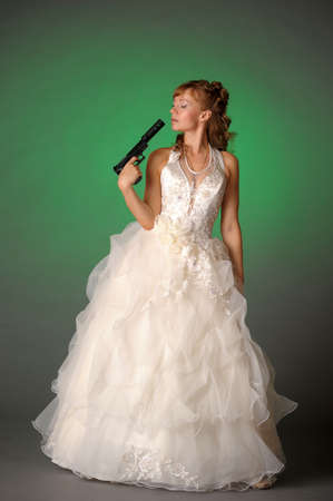 beautiful bride with a gunの写真素材