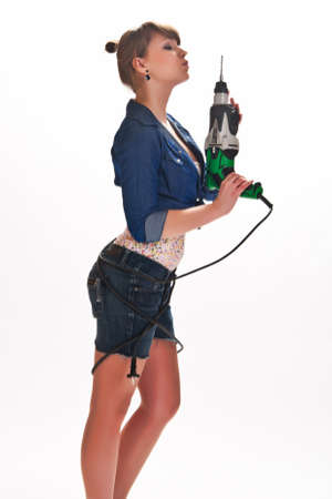 girl with a drill in the hands