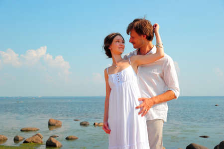 Photo for young couple in love on the shore - Royalty Free Image