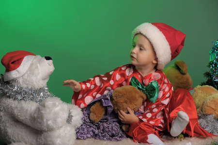 boy in the Christmas hat with toy bear