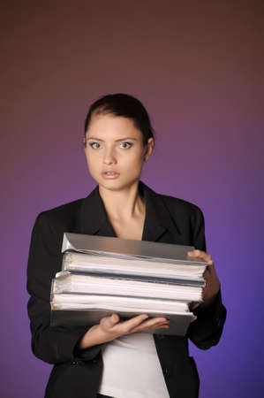 Business the woman with folders of papers