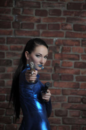 Martial young lady with gun