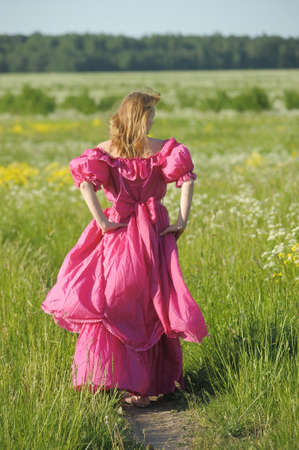 young woman in an retro dress in the field
