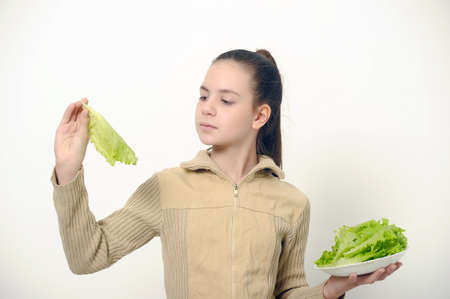 Young beauty girl with green lettuce