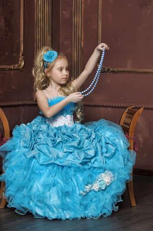 little girl in a smart blue dress