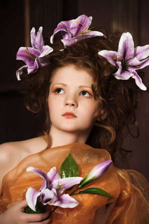 girl with lilac lilies in her hair