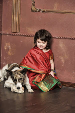 little girl in the national Indian suit with a dog