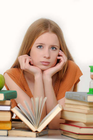 girl student with books, apple and sand-glasses