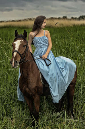 girl in long dress with a horse