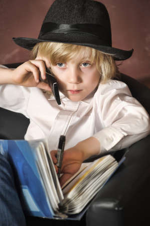 little boy in the role of a businessman