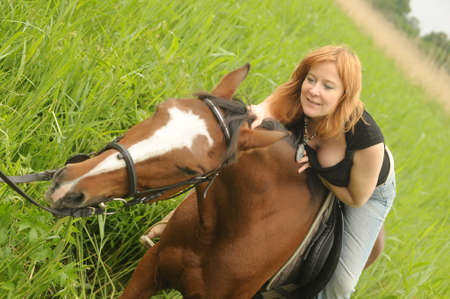 Woman   Horse in field or park