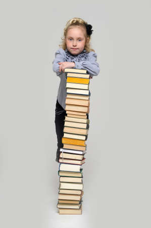 girl schoolgirl with a stack of books