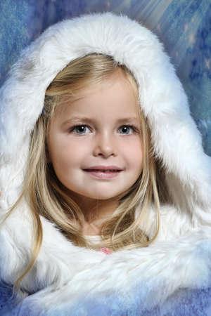 little girl in white fur bonnet