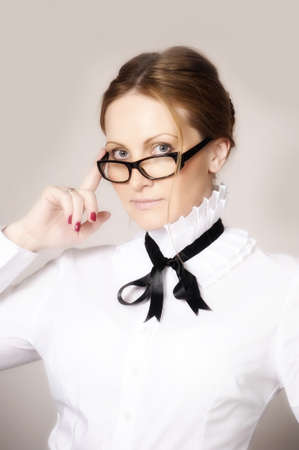 woman in a white blouse and glasses teacher