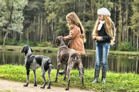 Two girls on a walk with the dogs