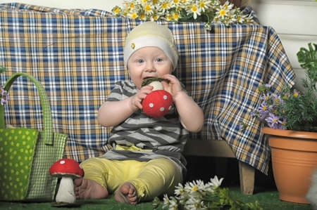 little girl with a toy fly agaric