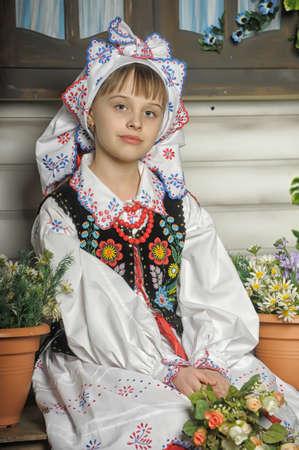 Girl in Polish national costume of Krakowの素材 [FY31019338034]