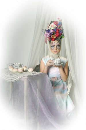 Girl with flowers on her head during a tea party