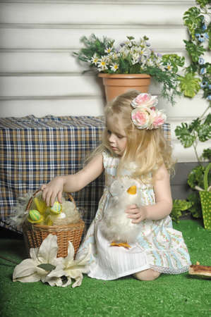 Little girl with basket of easter decoration