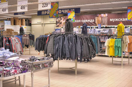 Mens clothing on hangers in shop