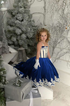 Girl in a smart blue dress lush.