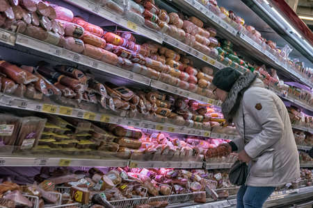 Shoppers in a supermarket in the sausage department, St. Petersburg, Russia.