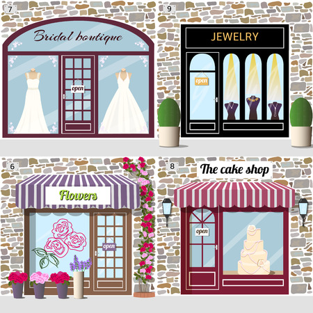 Set of wedding shops. Dummies in bridal dresses in the bridal boutique window.Dummies with golden necklaces in the jewelry shop window. Rose sticker on the flower shop window and climbing rose near the door. A big cake in the cake shop window.Building fac