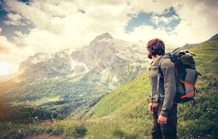 Photo pour Man Traveler with backpack hiking Travel Lifestyle concept mountains on background Summer journey adventure vacations outdoor - image libre de droit