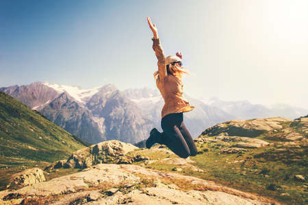 Foto de Happy Woman jumping up Flying levitation with mountains landscape on background Lifestyle Travel emotions success concept outdoor - Imagen libre de derechos