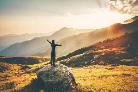 Photo pour Man raised hands at sunset mountains Travel Lifestyle success and wellness emotional concept adventure vacations outdoor hiking harmony with nature aerial view - image libre de droit