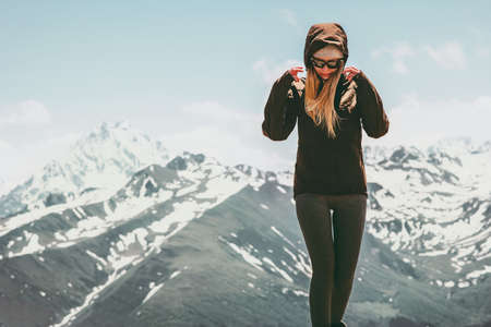 Young woman walking in mountains landscape Travel lifestyle concept active vacations outdoor