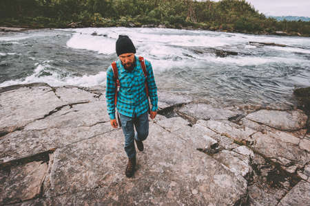 Man survival traveling hiking at river active healthy lifestyle adventure journey vacations outdoor