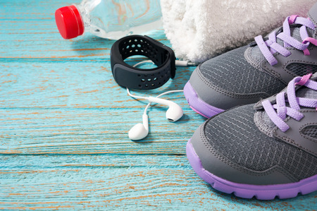 Workout set with sport shoes, earphones and heart rate monitor watch