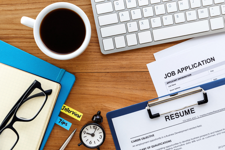 Photo pour Job search with resume and job application on computer work table background - image libre de droit
