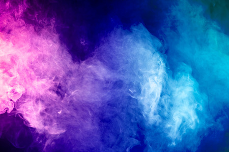 Photo pour Blue, red, pink abstract cloud of smoke pattern on a black isolated background - image libre de droit