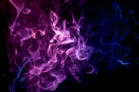 Purple and blue  cloud of smoke of  black isolated background. Background from the smoke of vape