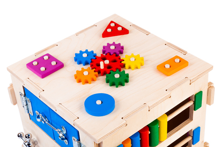 Photo for Wooden eco-friendly busy board - educational toy for children, babies on a white isolated background, consisting of multi-colored wooden puzzle pieces, maze, gear, sorter - Royalty Free Image