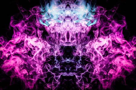 Photo pour Thick colorful smoke of blue, pink and purple  in the form of a skull, monster, dragon on a black isolated background. Background from the smoke of vape. Mocap for cool t-shirts - image libre de droit