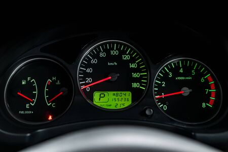 Photo pour Interior view of car with black salon. Modern luxury prestige car interior: speedometer, dashboard and tachometer  with green backlight and other buttons. Soft focus - image libre de droit